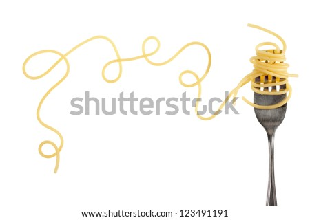 Swirls of cooked spaghetti with fork