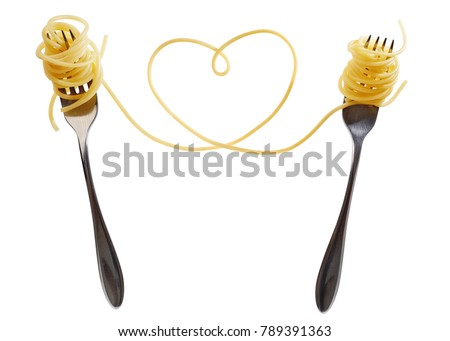 Swirls of cooked spaghetti with fork. Spaghetti heart shape.  #789391363