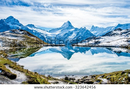 Swiss alps water reflection in  Bachalpsee - mountain lake above Grindelwald, Switzerland. #323642456