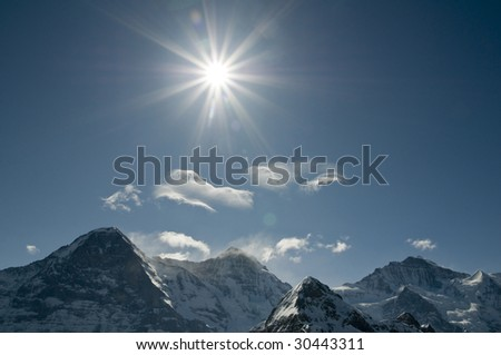 swiss alps with sun