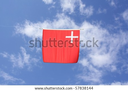 Swiss Canton Flag Series: Schwyz; the white cross is associated with Christ, the red color symbolizes the suffering of Christ.