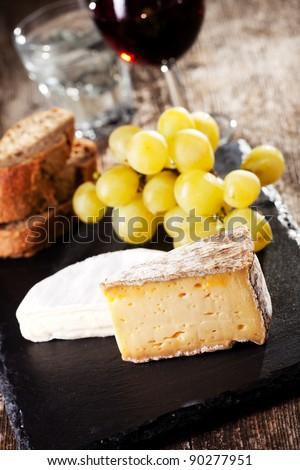 swiss cheese and red wine - stock photo