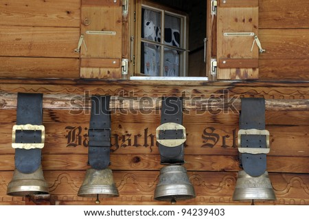 Swiss cow bells hanging outside traditional chalet
