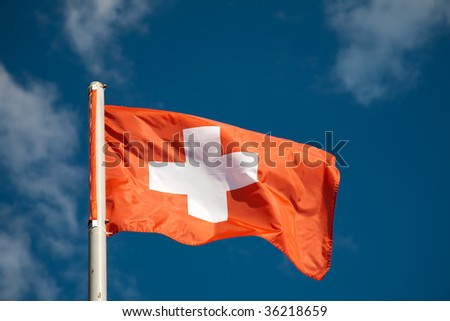 Swiss flag against blue sky