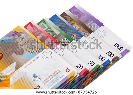 swiss francs lying on a white background