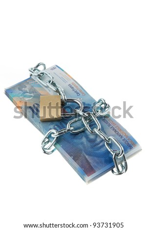 swiss francs notes with lock and chain. stack money for security and investment.