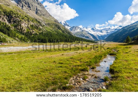 Swiss mountain landscape of the Morteratsch Glacier Valley hiking trail in the Bernina Mountain Range of the Bundner Alps.