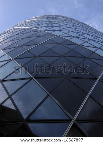 Swiss Re building also know as the Gherkin with bright blue sky London