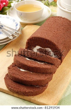 Swiss Roll  on the wooden cutting board