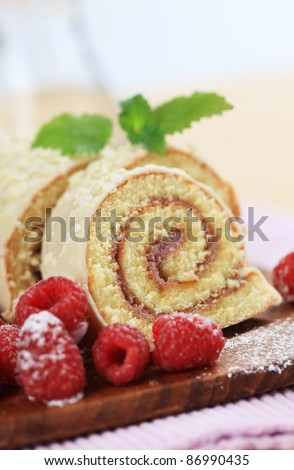 Swiss roll with fresh raspberries - stock photo