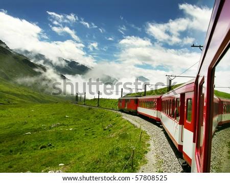Swiss train from Oberalppass to Andermatt, in Switzerland mountains.