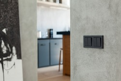 Switch and socket in the kitchen background