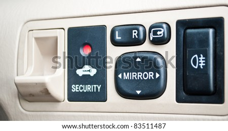 Switch in the car for open window. - stock photo