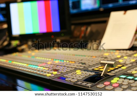 Switcher buttons in studio TV station, Audio and Video Production Switcher of Television Broadcast.