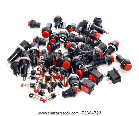 Switches, buttons, fuses, electronic components, on white background - stock photo