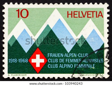 SWITZERLAND - CIRCA 1968: a stamp printed in the Switzerland shows Mountains and Emblem of the Swiss Women�s Alpine Club, 50th Anniversary, circa 1968