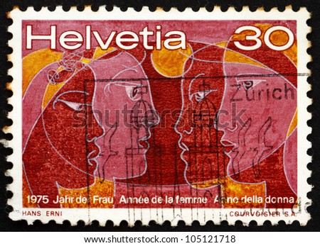 SWITZERLAND - CIRCA 1975: a stamp printed in the Switzerland shows Women of Four Races, International Womens Year 1975, circa 1975