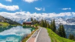 Switzerland, Engelberg, Shonegg lake with alps