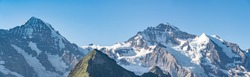 Switzerland, Panoramic view on Eiger, Monch and Jungfraujoch and green Alps around