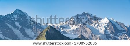 Switzerland, Panoramic view on Eiger, Monch and Jungfraujoch and green Alps around