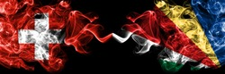 Switzerland, Swiss vs Seychelles, Seychellois smoky mystic flags placed side by side. Thick colored silky abstract smoke flags.