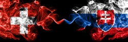 Switzerland, Swiss vs Slovakia, Slovakian smoky mystic flags placed side by side. Thick colored silky abstract smoke flags.