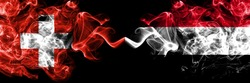 Switzerland, Swiss vs Yemen, Yemeni smoky mystic flags placed side by side. Thick colored silky abstract smoke flags.