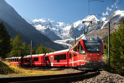 switzerland  train in front of glacier Morteratsch Bernina