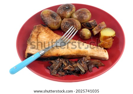 Swordfish steak cooked with fleur de sel potatoes with candied onions served in a plate close-up on a white background Stock fotó ©