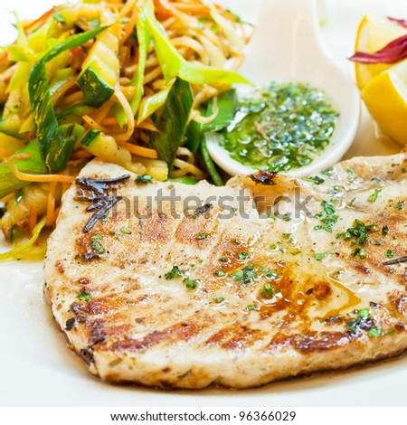 Swordfish steak with steamed vegetables and spices