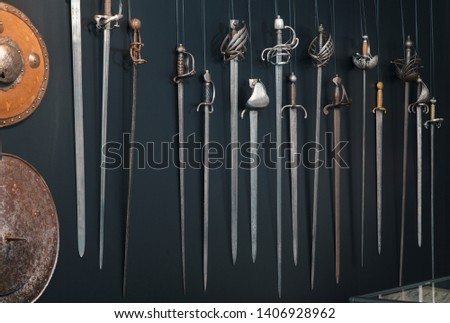 swords sabers rapires daggers Sword  medieval weapon of knight with sharp blade and pirates knife illustration broadsword set of battle-axe or knifepoint and spear isolated on black background #1406928962