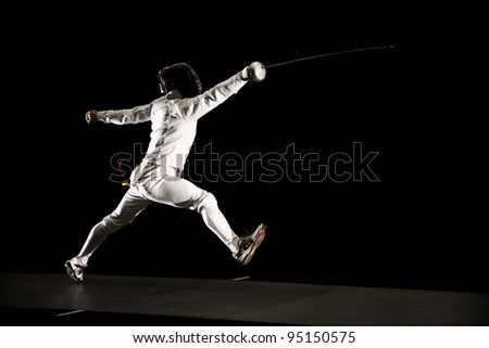 swordsman isolated on black background