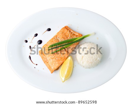 syake teriyaki on a white oval dish isolated on white background