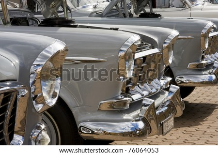SYDNEY - APRIL 22: The fronts of lined-up vintage Holden cars shine in sunlight in the car exhibition stall at the Royal Easter Show in Sydney Olympic Park Showground on April 22, 2011