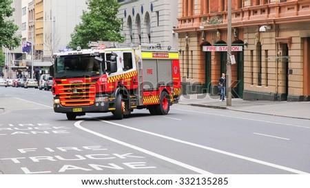 SYDNEY - AUSTRALIA - APR 22: Sydney Fire service, Fire Engine moving from a fire station on April 22, 2012. Sydney, Australia.