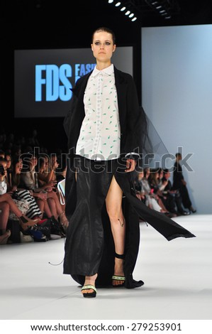 SYDNEY AUSTRALIA - 15 APRIL 2015: Mat Lee clothes collection fashion show runway presented by the Innovators Fashion Design Studio at Mercedes Benz Fashion Week at Carriageworks.