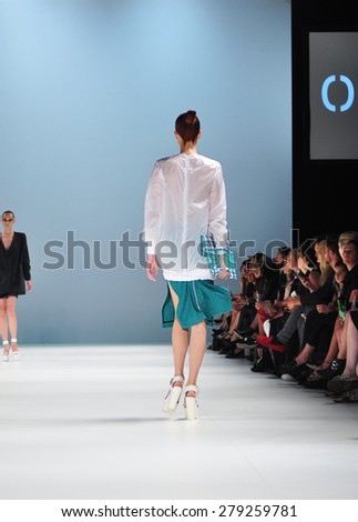 SYDNEY AUSTRALIA - 15 APRIL 2015: Onticha female clothes collection fashion show runway presented by the Innovators Fashion Design Studio at Mercedes Benz Fashion Week at Carriageworks.