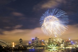 sydney australia CBD night scene new year fireworks celebration pyrotechnics ball high in dark sky color illumination