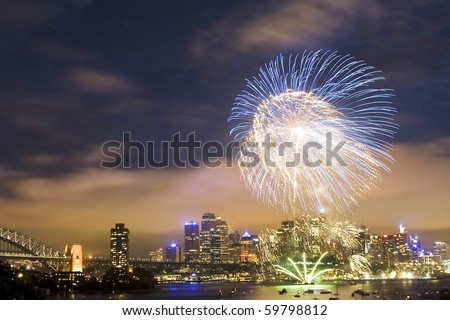 sydney australia CBD night scene new year fireworks celebration pyrotechnics ball high in dark sky color illumination