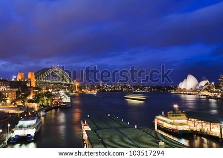 Sydney Australia Circular Quay at sunset view on Harbour Bridge, ferries, landmarks of city CBD