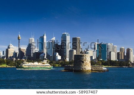 sydney australia city central business district view from harbour ferry over bay blue skyline fort denison