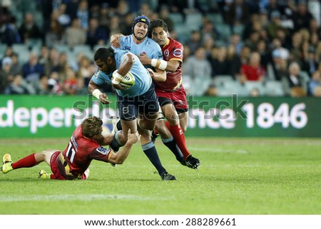 SYDNEY AUSTRALIA-June 2015, NSW Waratahs and Queensland Reds players in action during their Super Rugby clash at the Allianz Stadium, Sydney on 13 June 2015, in Australia