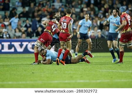 SYDNEY AUSTRALIA-JUNE 2015,NSW Waratahs and Queensland Reds players in action during their Super Rugby clash at the Allianz Stadium, Sydney 13 June 2015,  in Australia