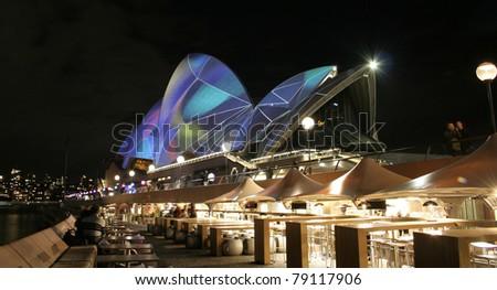 SYDNEY, AUSTRALIA - JUNE 6: Sydney Opera House lit up for the Vivid Sydney Festival, biggest international music and light festival in the southern hemisphere, June 6, 2011 in Sydney. - stock photo