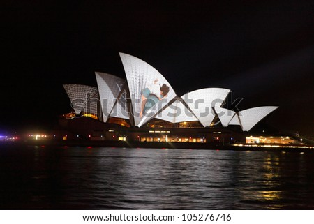 SYDNEY, AUSTRALIA - JUNE 11, 2012:  The Sydney Opera House becomes illuminated with spectacular motion picture art  during the annual Vivid Sydney Festival June 11, 2012
