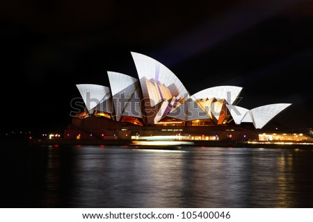 SYDNEY, AUSTRALIA - JUNE 11, 2012:  The Sydney Opera House becomes illuminated with spectacular art by various artists during the annual Vivid Sydney Festival on June 11, 2012