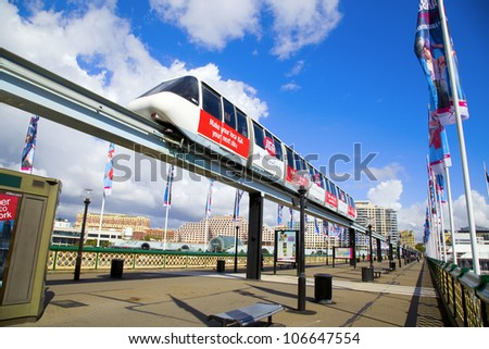 SYDNEY, AUSTRALIA - MARCH 22: A monorail runs above the public street in Darling Harbour area of Sydney on March 22,2012 in Sydney. The monorail is a unique public transport system in Sydneys CBD.