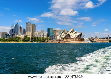 Sydney, Australia - March 2017. View of Sydney CBD on a sunny summer day with partly cloudy blue sky across Port Jackson. #1221478939