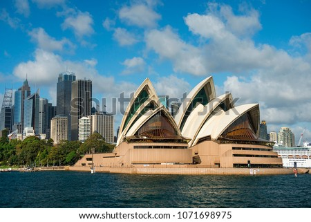 Sydney, Australia - March 24, 2018: view of the Sydney Opera House in the background of skyscrapers of Sydney central business district ( CBD ) #1071698975