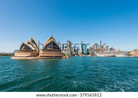 SYDNEY, AUSTRALIA - NOVEMBER 8, 2014: The Sydney Opera House and the Circular Quay cruise terminal at Sydney, Australia. Cityscape of Sydney Downtown. #379565812